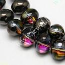 Stiklinis karoliukas , ovalo form., 13x16 , pusiau juodai dengtas , 1 vnt.